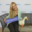 The Aflac Duck wears a specially designed necklace by Kendra Scott