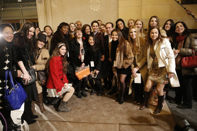 Zac Posen poses with American Express Platinum cardholders