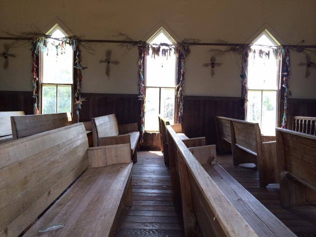 interior of church with pews in Luck TX on Willie Nelson's ranch after storm