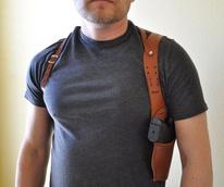Man with pistol in shoulder holster