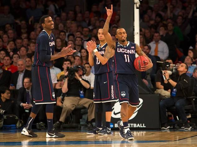 UConn players celebrate a big win