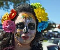 woman in Dia de Los Muertos skull face paint
