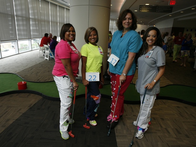 Participants in the Bad Pants Open kick-off party at Texas Children's Hospital