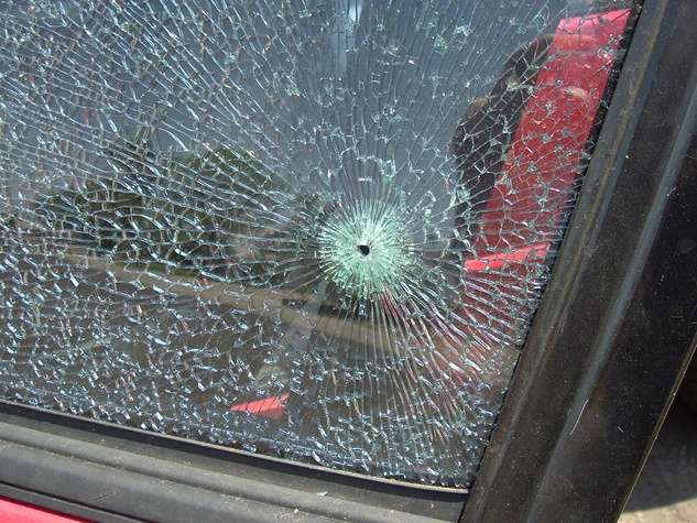 car window shot out bullet hole cracked glass