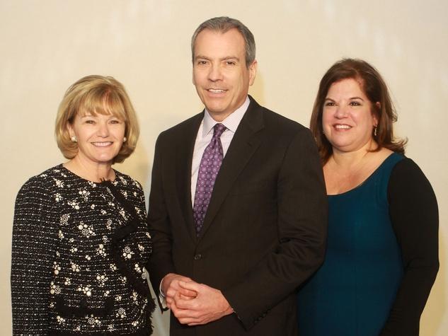 67 Hildegarde Ballard, from left, Bob Devlin, and Sonya Galvan at the Child Advocates luncheon December 2013