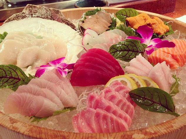 Kata Robata Sushi + Grill live scallop, hamachi belly, New Zealand salmon, kanpachi, maguro, abalone, toro, uni