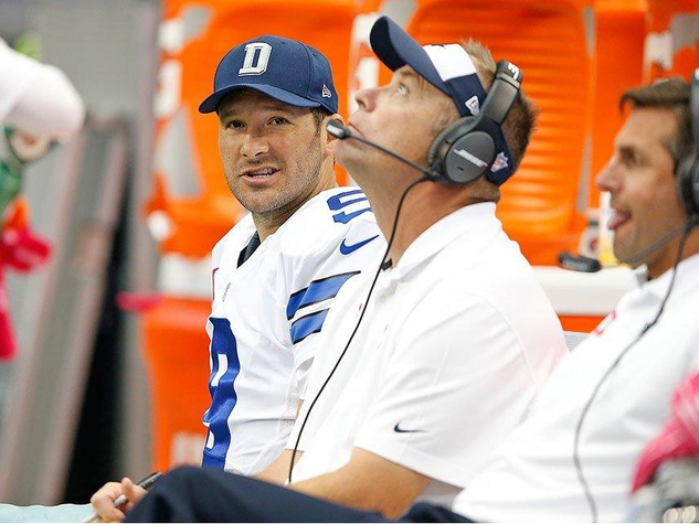 Tony Romo watches from bench