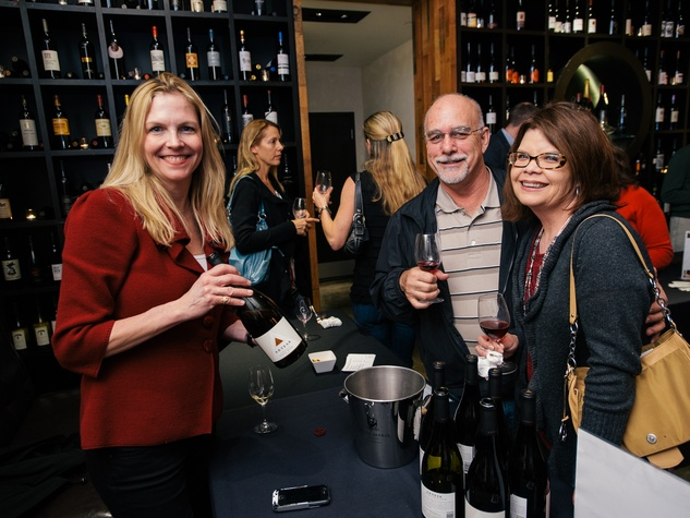 19 Danielle Ramdazo, from left, with Michael and Leticia Shelley at the Artesa wine tasting at Cru March 2014