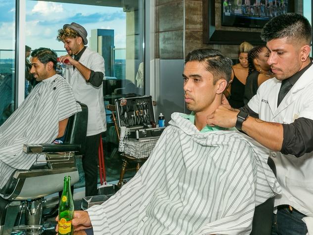 Shiraj Sen (Closest to the window), John Antonio (Green Shirt) haircuts by The Argyle League at CultureMap Social