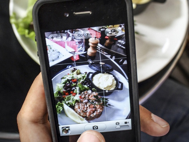 taking a photo of food with a cell phone
