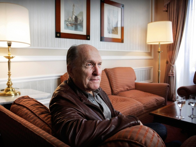 Robert Duvall sitting on couch
