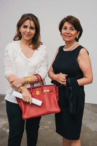 14 Mahnaz Amiralai, left, and Homa Taghi at the Amir Taghi launch May 2014