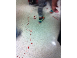 Stabbing at Spring High School September 2013 blood on floor WHITE BACKGROUND RUN FLAT
