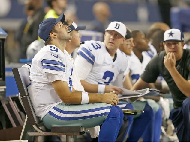 Tony Romo on the sidelines against Redskins