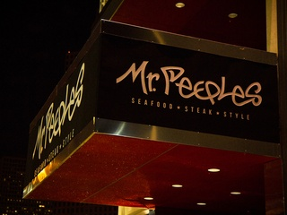 Mr. Peeples Houston restaurant exterior sign at night