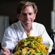 Bruce Molzan Corner Table chef with squash blossoms June 2014