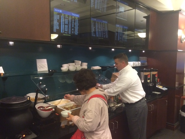 Passengers at United Club try the new food