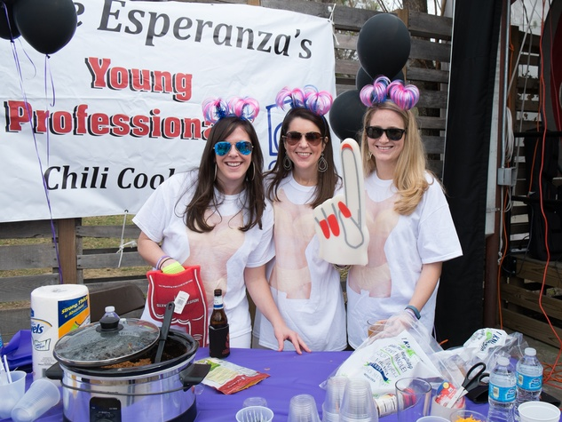Blair Burke, from left, Caroline Conway and Allison McConnell at the Casa de Esperanzas Young Professional Chili Cook-off February 2014
