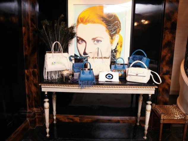 Dee Ocleppo handbags in front of Grace Kelly portrait at Plaza apartment