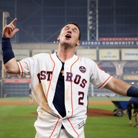 Astros Alex Bregman celebrates after hitting the game-winning single during the tenth inning to defeat the Los Angeles Dodgers in Game 5 of World Series