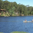 canoeing in Bastrop State Park with cabin in back