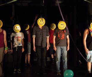 New York Neo-Futurists improv theater group smiley face 2015