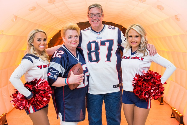141 Cheerleader Kristy, from left, Dr. Jayne Finkowski-Rivera, Dr. Carlos Rivera and Cheerleder Kim at the Camp For All Super Ball February 2015