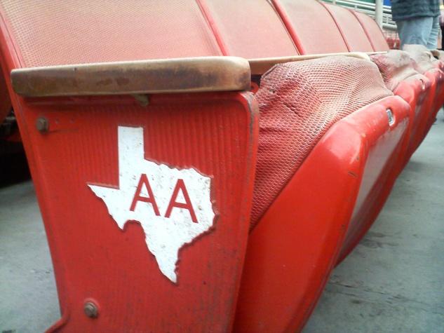 Astrodome orange seats cracked with Texas emblem