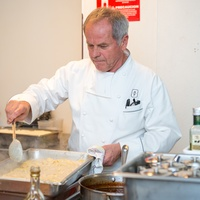 336 Wolfgang Puck preparing second course in the kitchen at the Houston Symphony Wolfgang Puck wine dinner March 2015