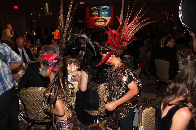 Gala Del Museo Arte Y Glamour benefiting the Mexic-Arte Museum. Danza Azteca Guadalupana enter the ballroom