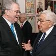 Tom Johnson, left, and Henry Kissinger