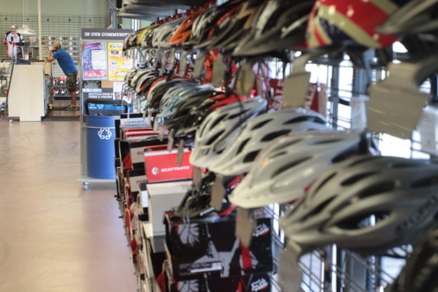 Helmets hang on the walls at Performance Bike