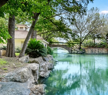 Glide right out onto tranquil Lake Austin from this fabulous estate