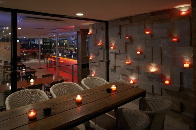 Austin Photo Set: News_Adrienne Breaux_Jamie Chioco_July 2011_starbar candle wall