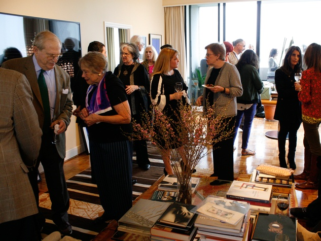 The crowd at at Slavka Glaser's FotoFest reception March 2014