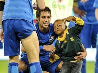 Boy with Neymar on field