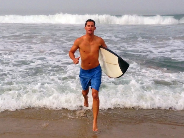 1 Kalon McMahon running on beach with surfboard