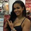 Love & Hip Hop Hollywood reality star Rosa Acosta is passing out samples of her perfume, Rosa, at Cosmoprof 2017