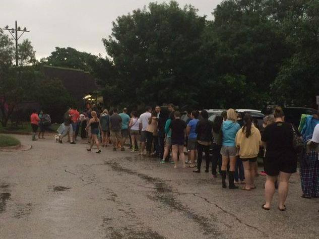 Town Lake Animal Center_Austin Pets Alive_flood_adoption line_May 2015