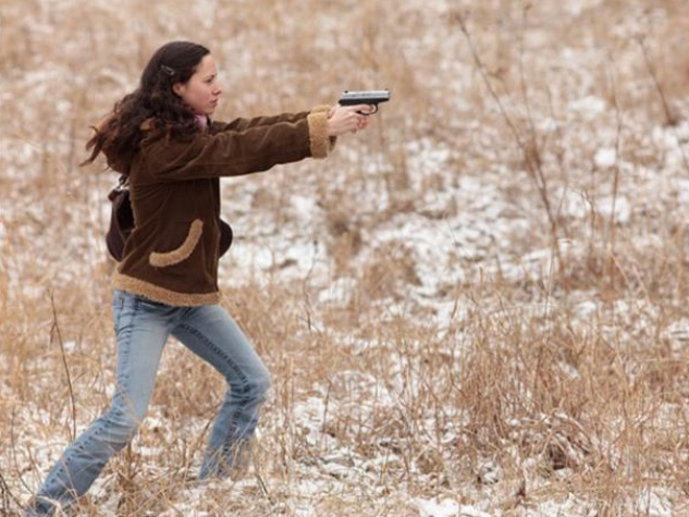 Woman aims her gun