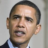News_Barack Obama_at mic_presidential seal