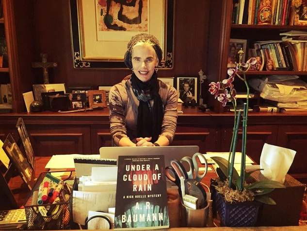 News, Alison Baumann with book,  Jan. 2016