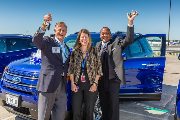 Davide Burr, left, and Kelvin Jones, right, receive Free cars for perfect attendance at United Airlines