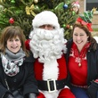 15 Susan Soussan, from left, Santa and Christin Kirchner at Mission of Yahweh's gift-giving celebration December 2013