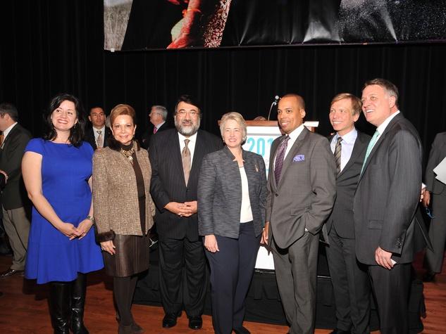 Gwendolyn Zepeda, from left, Philamena Baird, Roman Martinez, Mayor Annise Parker, Ronald Green, Jonathon Glus and Marc Melcher