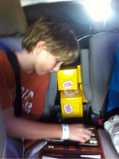 Kid playing backgammon in the car