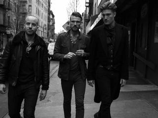 new york band The Kin walking down a street