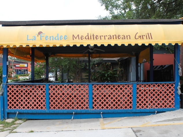 La Fendee patio exterior with sign on awning