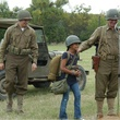 Kid with reenactors of World War II at Camp Mabry for Texas Military Forces Museum