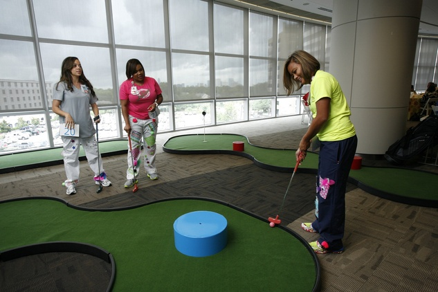 Texas Children's Hospital NICU nurses take a short break from work with a few rounds of putt-putt at the Bad Pants Open kick-off party